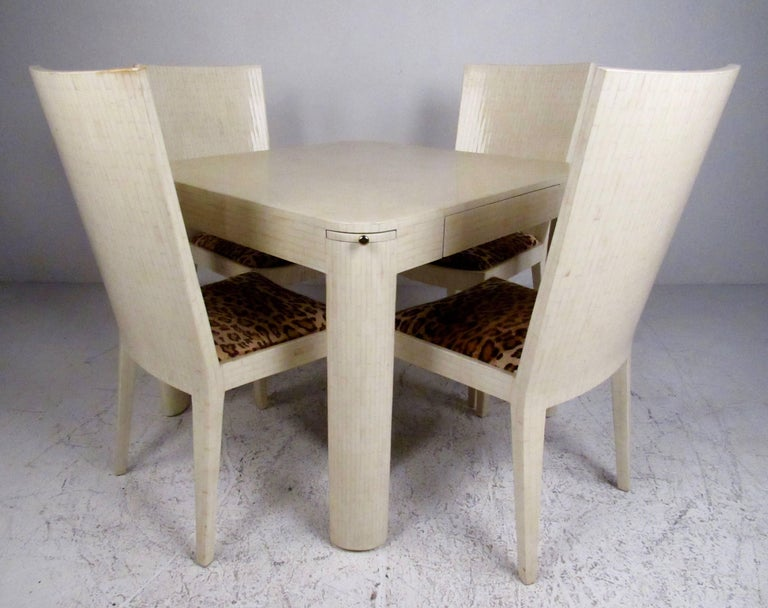 This stylish matching parlor set includes vintage modern game table and set of four matching high back chairs. Designed by Mid-Century master Enrique Garcel of Colombia for Jimeco ltda, this set of five makes an impressive addition to any home or