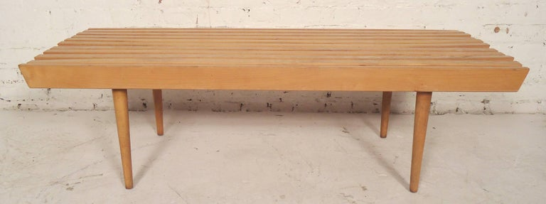 Classic vintage modern table or bench in the style of a George Nelson slat bench. Tight wood slats and tapered cone legs.