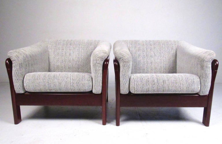 This comfortable pair of contemporary modern lounge chairs make a stylish addition to any home or business seating area. Clean lines, plush upholstery, and rich wood finish add to the appeal of the matching chair. Please confirm item location (NY or