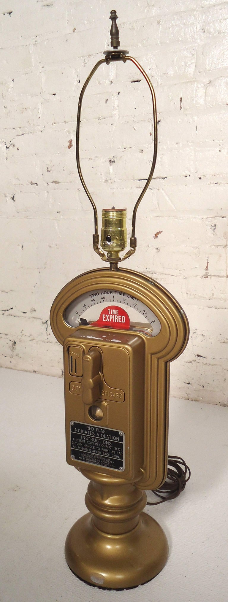 This vintage Duncan Miller city of Chicago parking meter table lamp is very unique, features many parking meter attributes, a heavy body, made from a real Chicago parking meter.