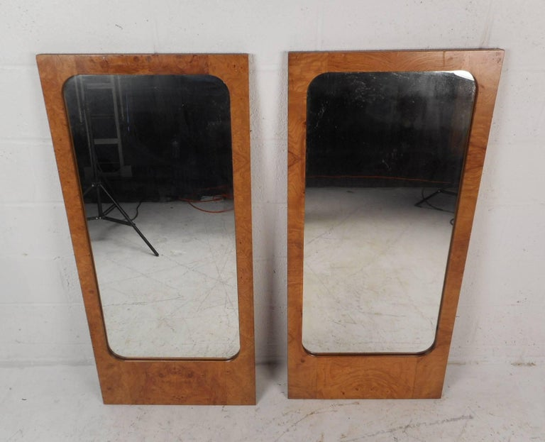 This gorgeous vintage modern pair of mirrors feature a lovely burl maple frame. Sleek rectangular design with elegant wood grain throughout makes this wonderful pair the perfect addition to any modern interior. These mirrors were designed for Lane
