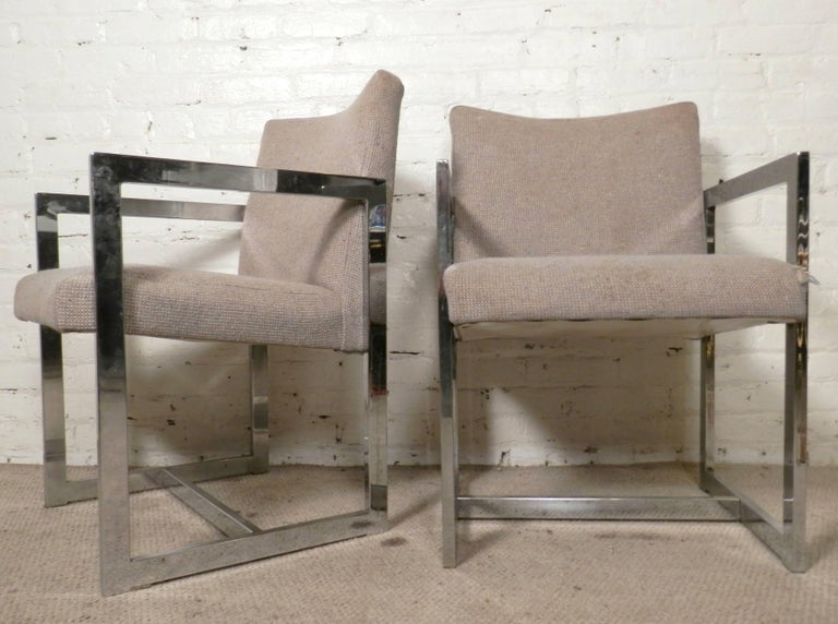 Sleek Mid-Century Modern polished chrome chairs. Milo Baughman style side chairs with straight angular lines and cushioned seat and back.  (Please confirm item location - NY or NJ - with dealer).