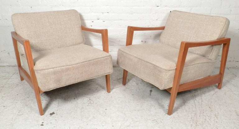 Maple wood frame arm chairs with thick cushioned seat and back. Wood arms have a nice sculpted shape for comfort and style.  (Please confirm item location - NY or NJ - with dealer)