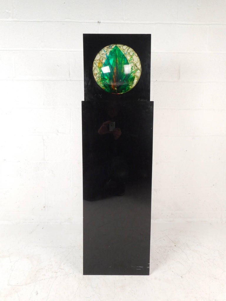 This gorgeous vintage modern sculpture stands 50 inches high and features a unique cube pedestal base. Sitting comfortably on top is a square casing with a unique and colorful globe. This stunning piece of art shows intricate detail and creativity