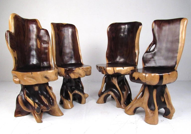 This exquisite matched set includes a stunning game table with four matching chairs. The natural root formation of the wood is accentuated by detailed artisan sculpting, while the two tone finish makes a striking addition to home or business