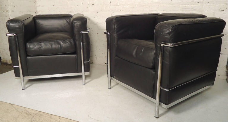 Pair of Mid-Century Modern chrome framed leather cube chairs by Cassina. Classic style that moves perfectly into a modern home or office.