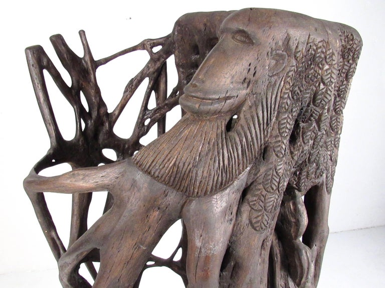 This impressive large-scale sculpture stands over five feet tall and features natural tree trunk/root elements combined with artistic hand-carved design including animal and abstract details. Mounted on plywood base with decorative finish. This