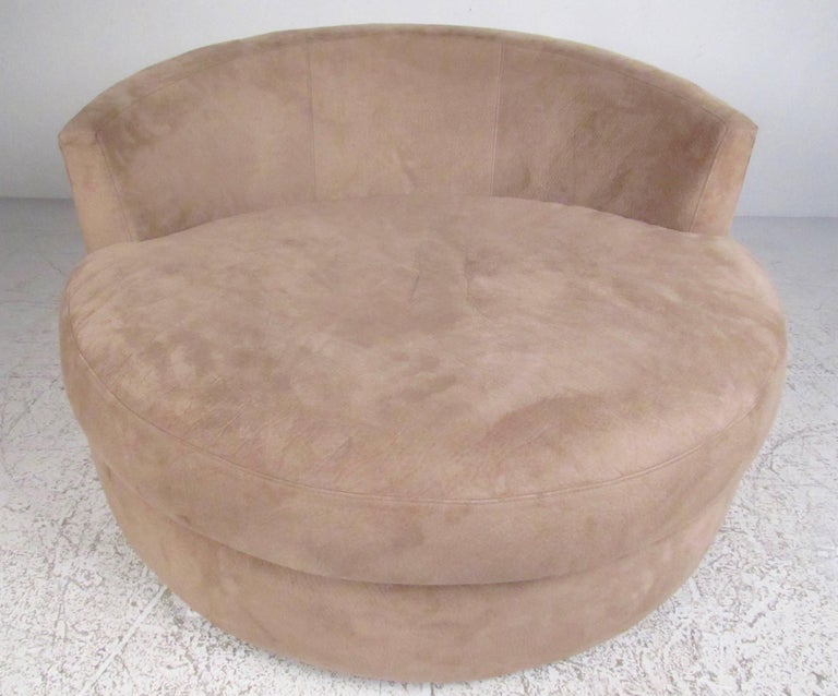 This unique disc style lounge chair after Adrian Pearsall features contemporary modern style, suede-like upholstery, and stylish design. Please confirm item location (NY or NJ).