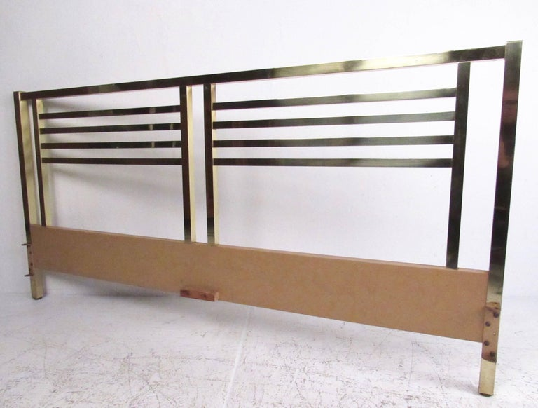 This unique brass headboard features stylish Mid-Century Modern design and measures 78 inches wide. Unique patina adds to the vintage appeal of the piece, making it a great addition to any interior. Please confirm item location (NY or NJ).