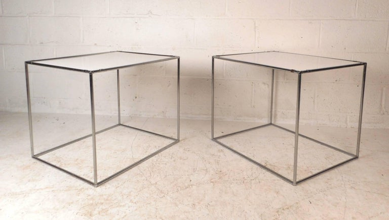 This beautiful pair of vintage modern end tables feature a unique chrome rod frame. Sleek and sturdy design with a white tabletop. This unusual midcentury pair makes the perfect addition to any modern interior. Please confirm item location (NY or