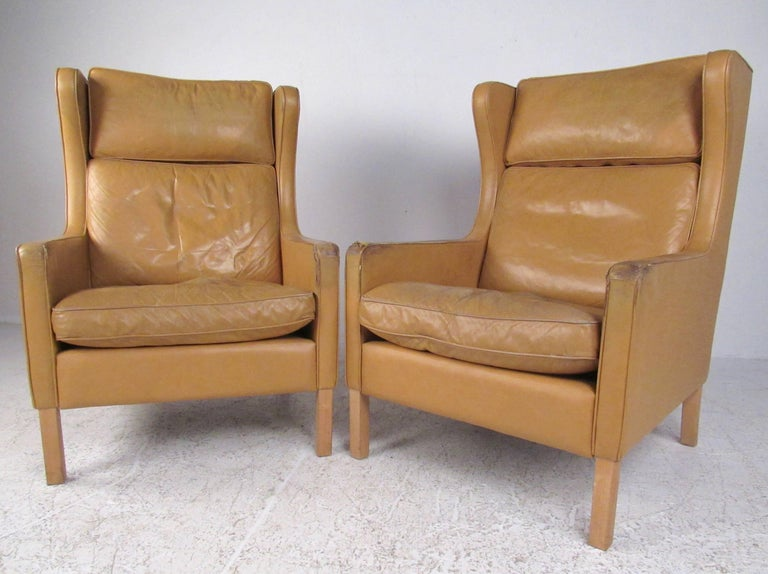 Mid-Century Modern Pair of Børge Mogensen Wing Back Leather Chairs with Ottomans For Sale