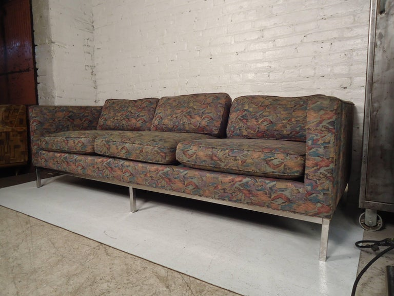 Mid-Century Modern three-seat sofa with polished chrome trim and legs. Handsome design with upholstered back.  (Please confirm item location NY or NJ with dealer).