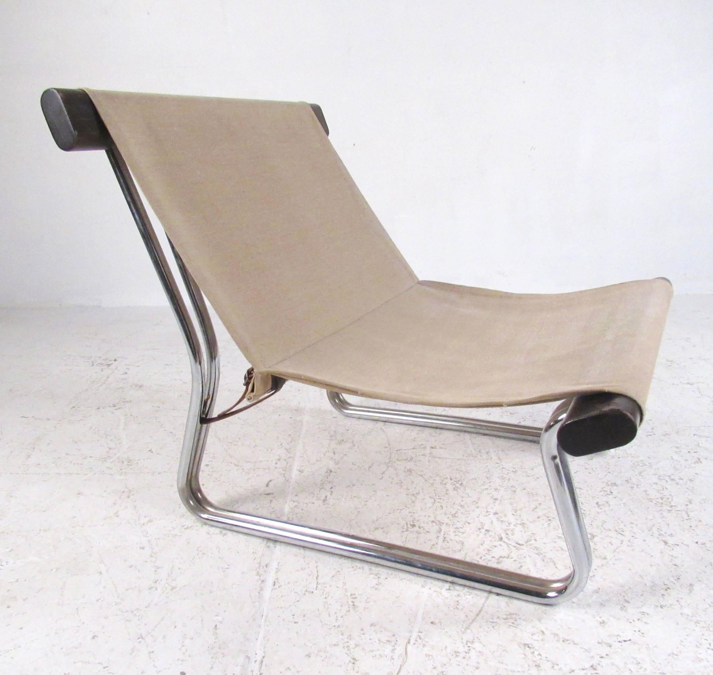 This Vintage Modern Sling Chair Features Tubular Chrome And Wood Frame With  A Canvas Seat.