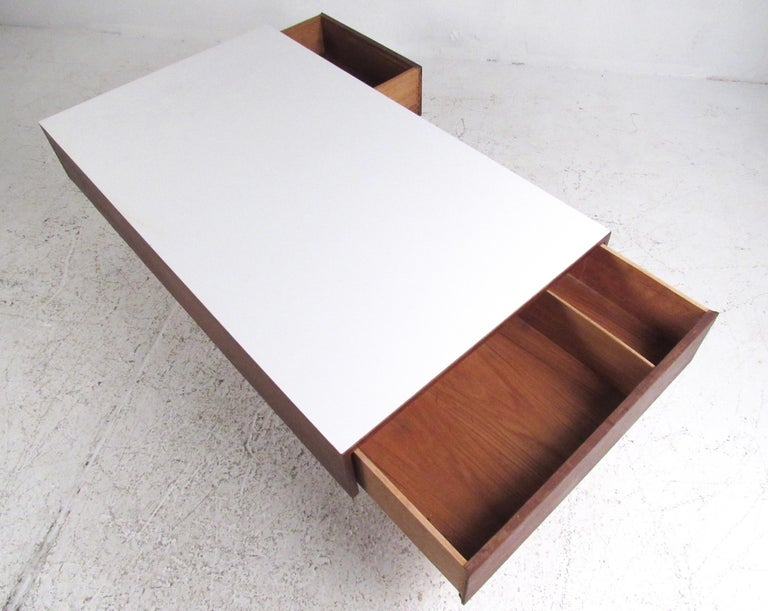 This Large Mid Century Modern Walnut Coffee Table Features Tapered Legs Two Storage Drawers