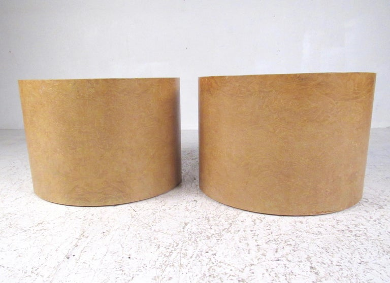 This stylish pair of vintage modern end tables feature a maple burl finish and cylindrical design of Intrex furniture. The unique style of the pair make them an elegant addition to home or business setting as end tables or pedestals. Please confirm