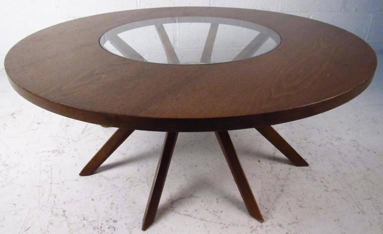 Beautiful vintage coffee table features sculpted legs, round top with glass center, manufactured by Broyhill.  Please confirm item location NY or NJ with dealer.