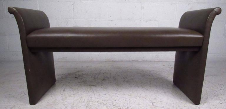 Vintage-modern window bench features sculpted sides and vinyl upholstery, making a stylish yet useful seating option for bedroom, changing room, or business.   Please confirm item location NY or NJ with dealer.