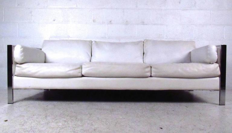This vintage vinyl sofa features comfortable cushioning and sleek midcentury design. Sturdy chrome frame with strong lines adds to the appeal. Comfortable and stylish seating addition to any interior. Please confirm item location (NY or NJ).