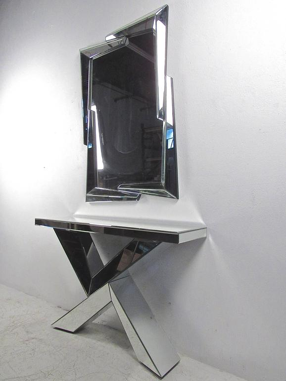 This beveled edge pair combines the unique cut-away design of the wall mirror with the perfect angles of the console's X-style base. Perfect mirror and table combination for foyer, hall, or showroom. Please confirm item location (NY or NJ). Mirror