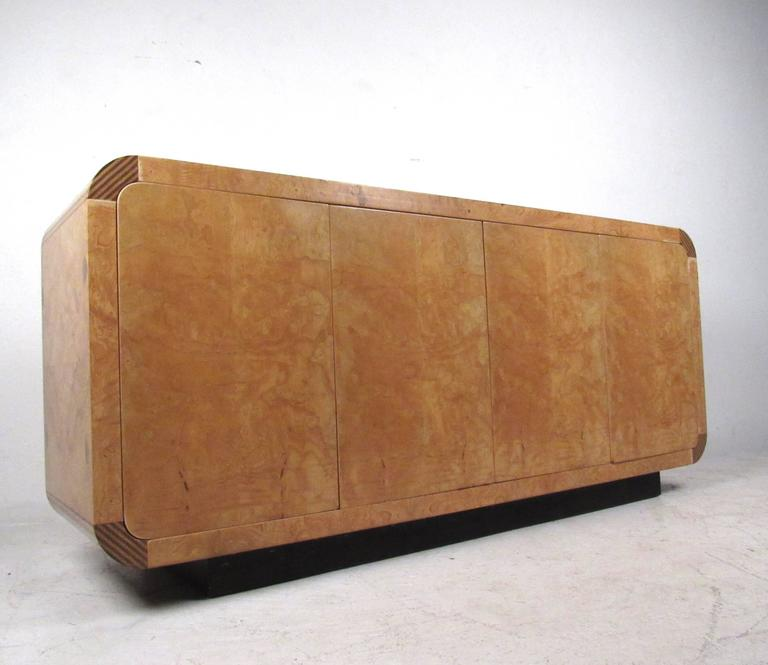 This vintage burl wood credenza by Henredon makes a stylish storage piece for any room. Quality construction, decorative corner inlays, and adjustable shelves round out some of the features of this uniquely sized credenza. Please confirm item