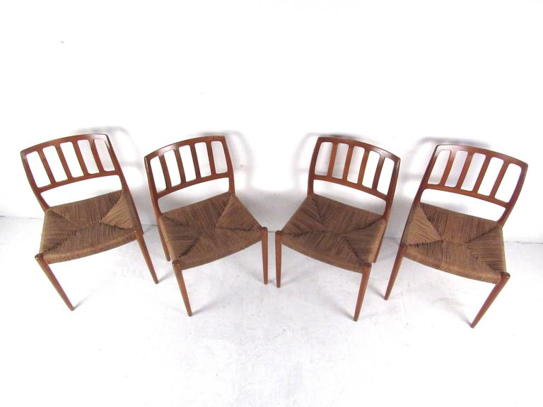 Mid-Century Modern N.O. Møller Teak and Rush Seat Dining Chairs For Sale