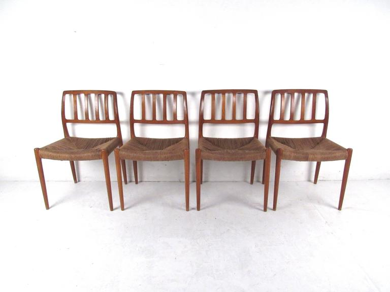 Danish N.O. Møller Teak and Rush Seat Dining Chairs For Sale