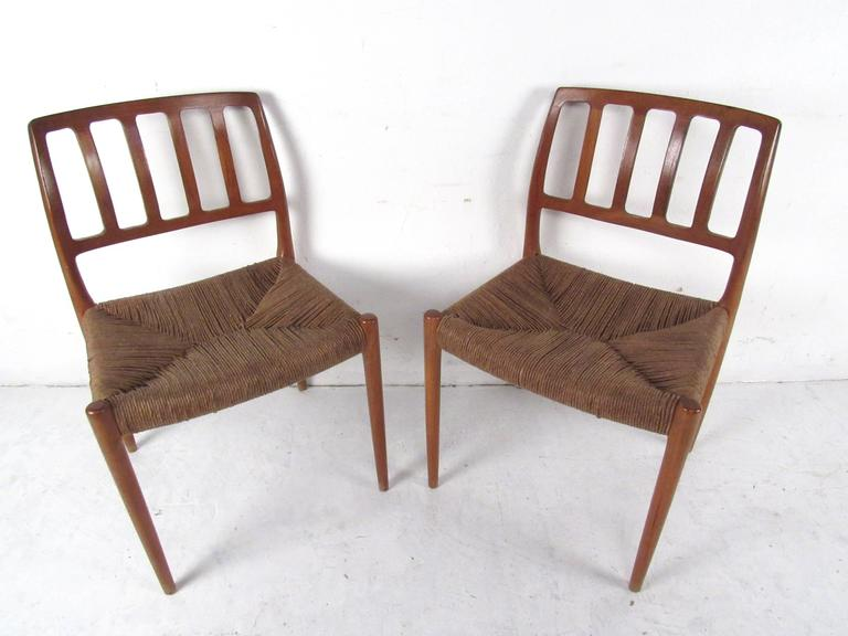 Mid-20th Century N.O. Møller Teak and Rush Seat Dining Chairs For Sale