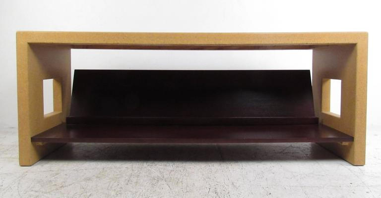 Unique lacquered cork and wood console table with literature shelf by noted American designer Paul Frankl, 1886-1958. Manufacturers stamp.  The understated magnificience of this vintage console by Frankl makes it an appealing view from every angle,