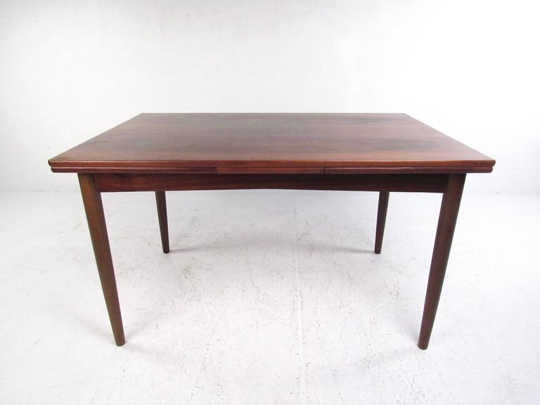 Mid-Century Danish Rosewood Expandable Dining Table By N.O