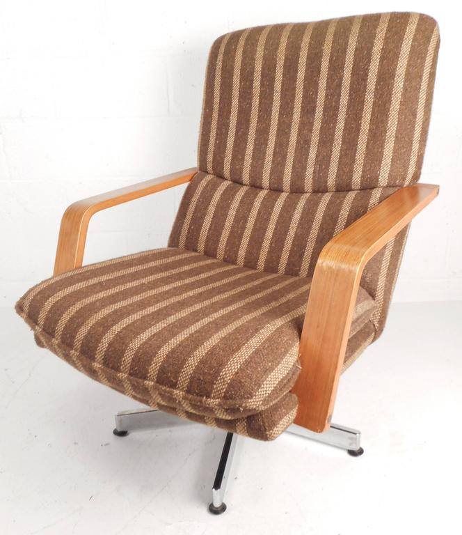 mid century modern teak and chrome swivel lounge chair with ottoman for sale at 1stdibs. Black Bedroom Furniture Sets. Home Design Ideas