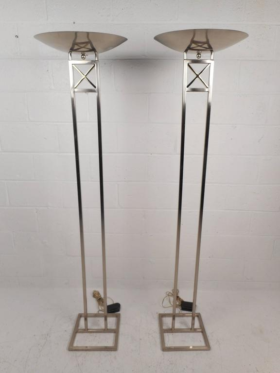 "Stunning pair of Mid-Century Modern floor lamps feature a tall polished chrome frame with a 17"" diameter shade on top. The beautiful brass ""X"" design on the top and stylish squared off base make them perfect for any modern setting."