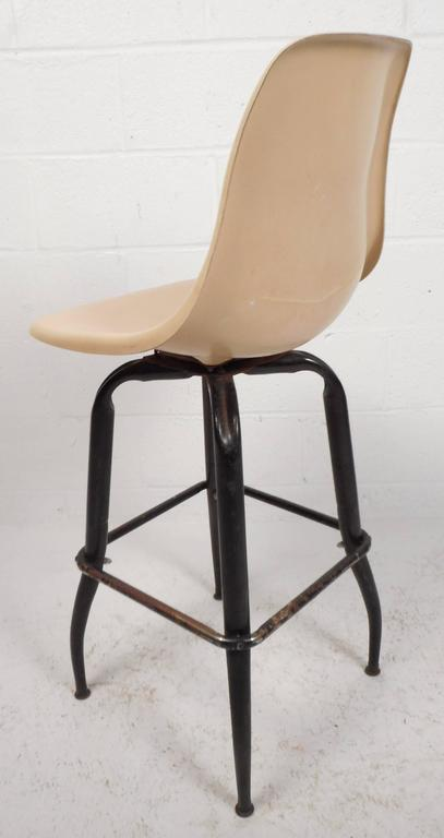 Late 20th Century Set of Mid-Century Modern Plastic and Iron Swivel Bar Stools For Sale
