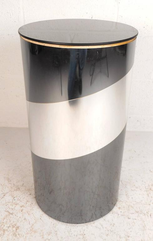 Stunning vintage modern pedestal features a cylinder shape layered with chrome strips and a mirrored top. Unique design can be used for a side table or a decorative piece. The Classic retro appearance makes it the perfect addition to any modern