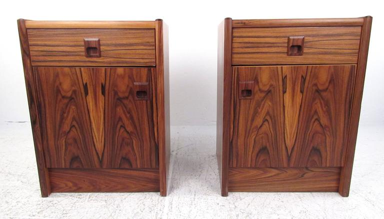 Pair of single drawer rosewood nightstands with storage compartment below.