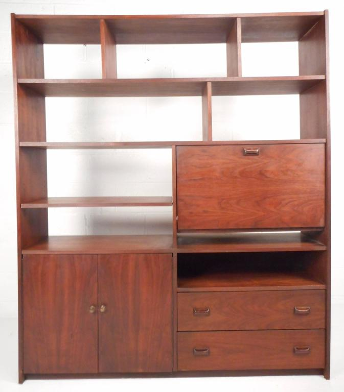 This impressive vintage modern book shelf features nine visible shelves two hefty drawers a & Large Mid-Century Modern Walnut Book Case For Sale at 1stdibs