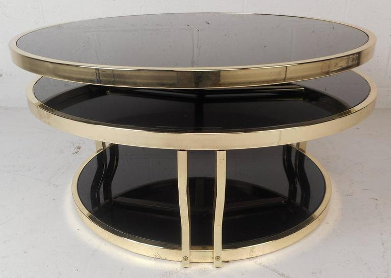 Mid Century Modern Italian Brass And Smoked Glass Swivel Coffee Table For  Sale 1