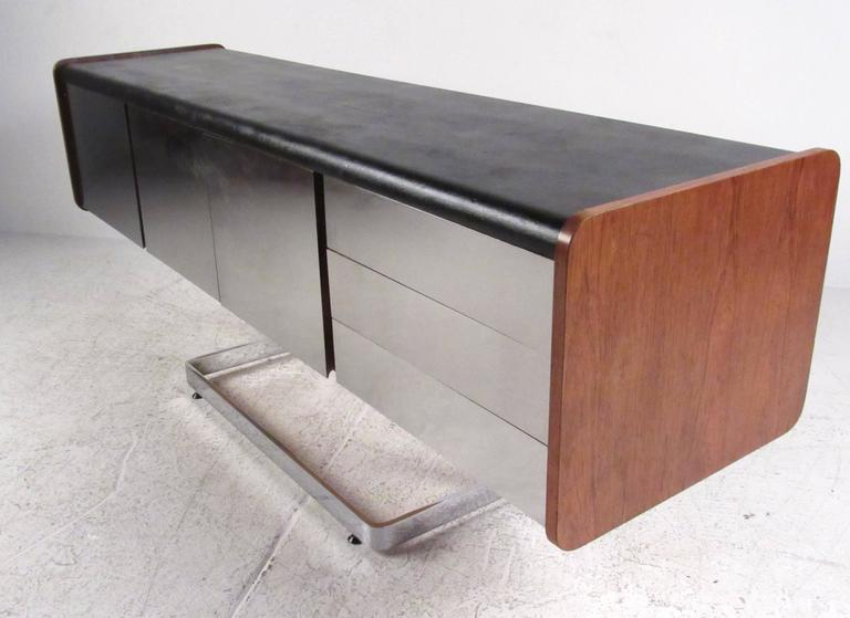 Chrome front cantilevered credenza with inset black leather top and walnut side panels by Ste. Marie & Laurent. Please confirm item location (NY or NJ) with dealer.