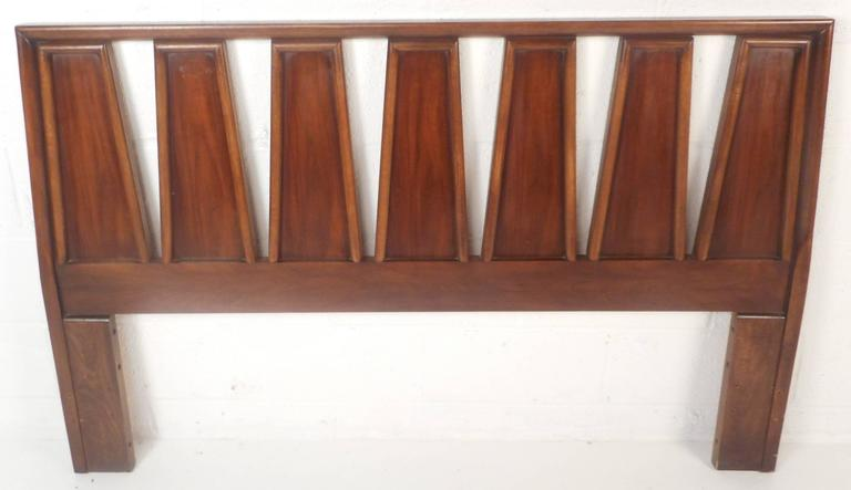 Stunning vintage modern queen-size headboard with unique pattered design and embossed trim. Sleek appearance with beautiful walnut wood grain makes this Mid-Century piece the perfect addition to any modern interior. Please confirm item location (NY