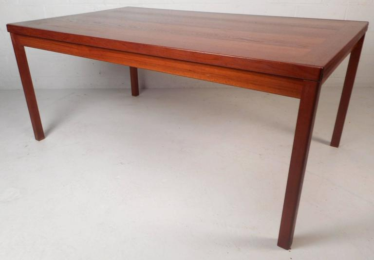 Impressive Mid-Century Modern Teak Draw-Leaf Dining Table In Good Condition For Sale In Brooklyn, NY