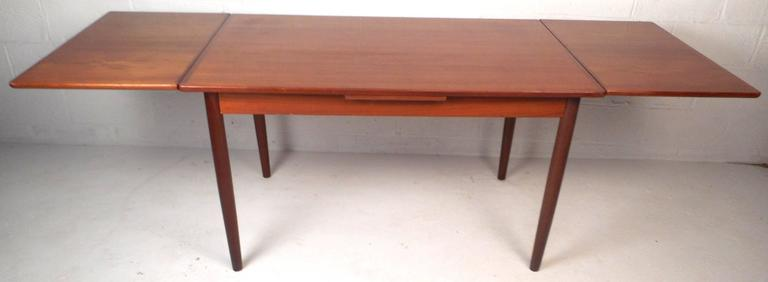 Late 20th Century Mid-Century Modern Teak Draw-Leaf Dining Table For Sale