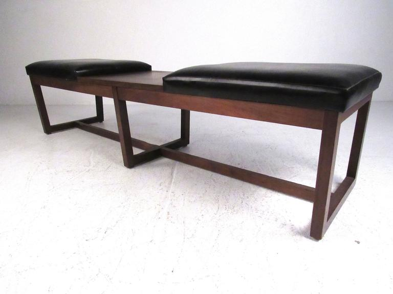 Mid century walnut frame bench seat with black vinyl upholstered cushions and laminate covered center table. Please confirm item location (NY or NJ) with dealer..