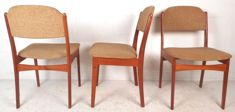 This elegant set of six vintage modern dining chairs feature sculpted frames with angled legs and back rests. Sleek design offers wide and comfortable seating without sacrificing style. Quality construction ensures sturdiness making this mid-century
