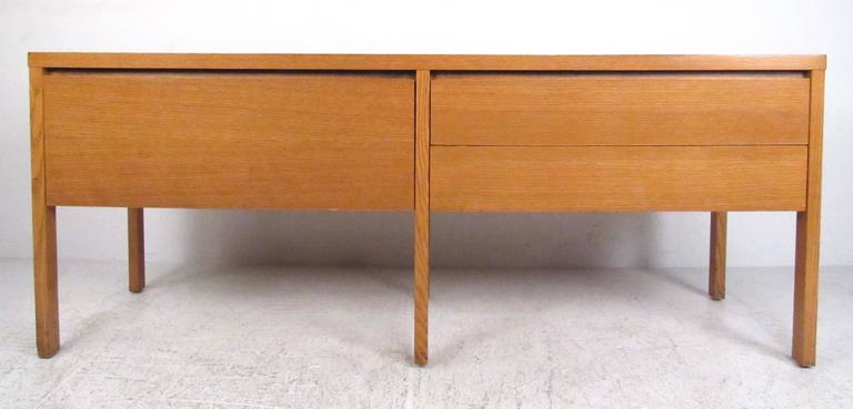 Three-drawer oak office credenza with two storage drawers on the right and single deep pendaflex folder drawer on the left. Nice smaller scale cabinet with clean lines and finished back. Please confirm item location (NY or NJ) with dealer.