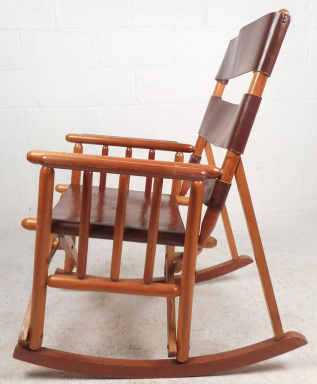 Beautiful Vintage Modern Rocking Chair With Three Thick Strips Of Leather  On The Backrest And A