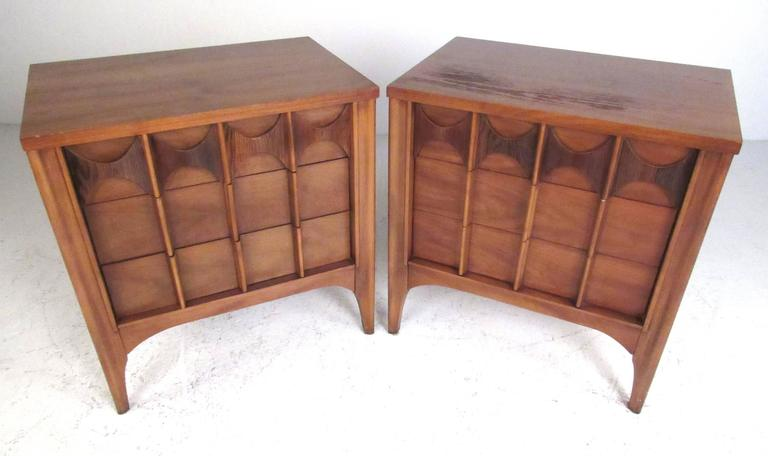 Pair of Mid-Century walnut and pecan three-drawer nightstands by Kent Coffey for the Perspecta Series furniture line. Please confirm item location (NY or NJ) with dealer.