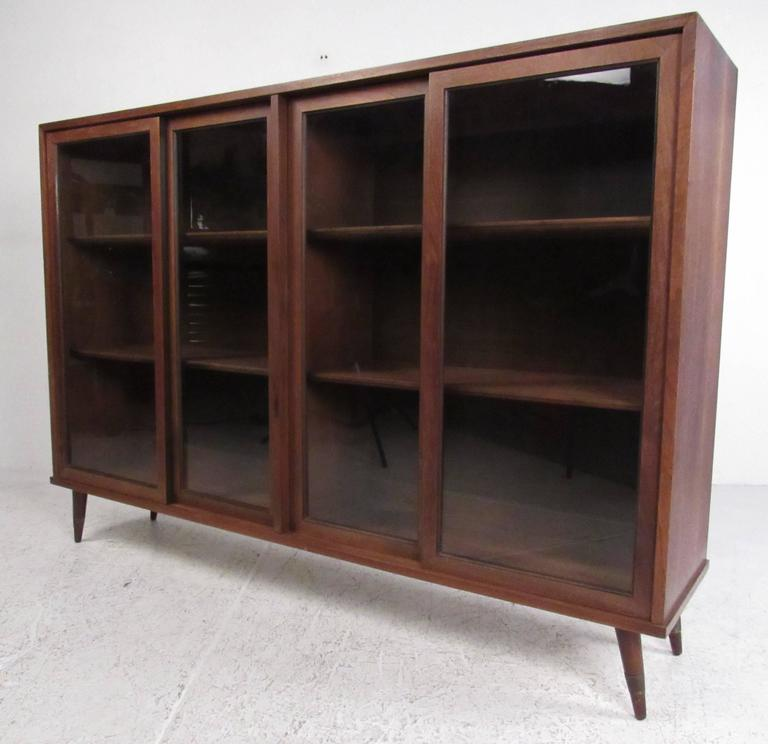 American walnut sliding door china cabinet with two display shelves. Please confirm item location (NY or NJ) with dealer.