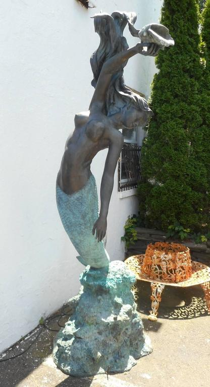 This Elegant Bronze Fountain Displays A Mermaid On Top Of A Coral Rock  Formation Holding A