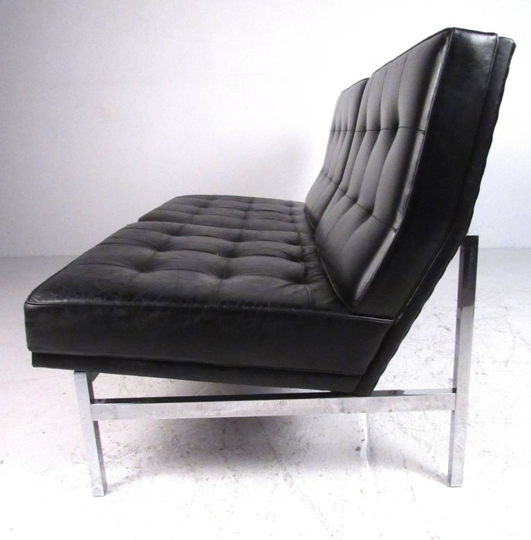 Classic Mid-Century Modern style two-seat leather tufted sofa supported by a tubular chrome frame. Comfortable and stylish design ideal for both home or office environments. Please confirm item location (NY or NJ) with dealer.