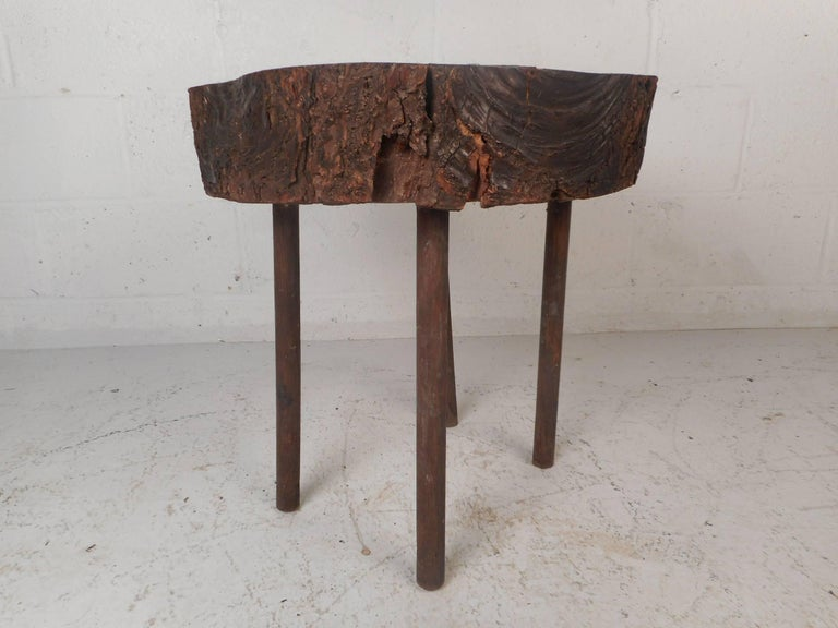 This beautiful vintage modern end table features a live edge tree slab top. Stylish design with four cylindrical wood legs and a lacquered free-form wood top. Quality craftsmanship makes this mid-century side table the perfect addition to any modern