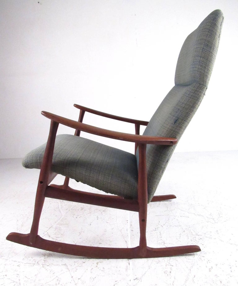 Vintage rocking chair with midcentury styling from Denmark, circa 1960. Very comfortable with solid teak construction, this Classic Danish design fits easily into any residential environment. Please confirm item location (NY or NJ) with dealer.